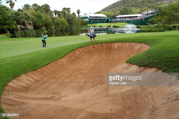 Martin Kaymer of Germany hits his second shot on the 18th hole during the third round of the Nedbank Golf Challenge at Gary Player CC on November 11...