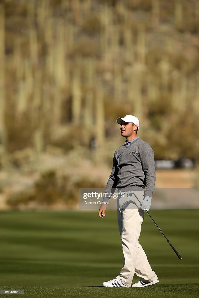Martin Kaymer of Germany hits his second shot on the par 4th 17th hole during the third round of the World Golf Championships - Accenture Match Play at the Golf Club against Hunter Mahan at Dove Mountain on February 23, 2013 in Marana, Arizona.