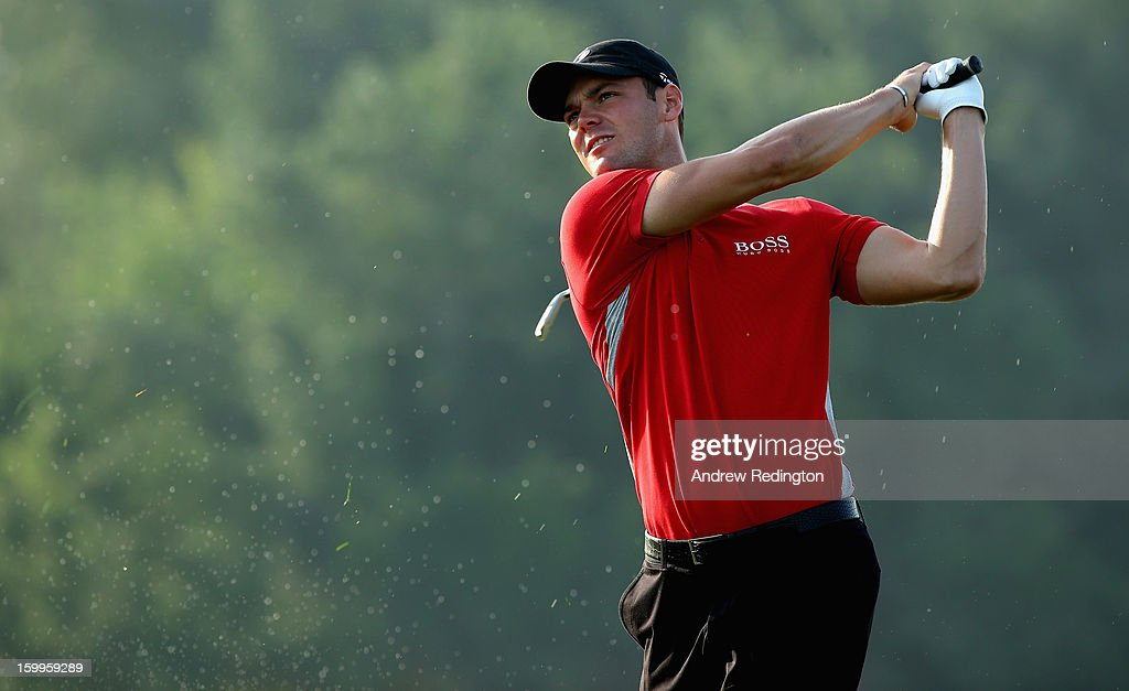 <a gi-track='captionPersonalityLinkClicked' href=/galleries/search?phrase=Martin+Kaymer&family=editorial&specificpeople=2143733 ng-click='$event.stopPropagation()'>Martin Kaymer</a> of Germany hits his second shot on the tenth hole during the second round of the Commercial Bank Qatar Masters held at Doha Golf Club on January 24, 2013 in Doha, Qatar.