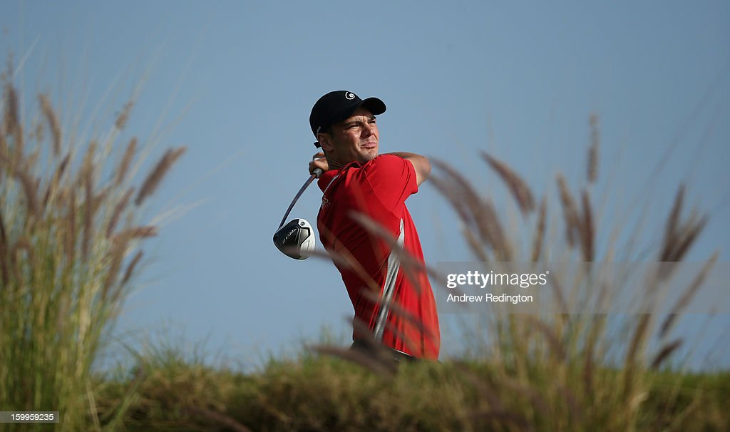 Martin Kaymer of Germany hits his tee-shot on the 16th hole during the second round of the Commercial Bank Qatar Masters held at Doha Golf Club on January 24, 2013 in Doha, Qatar.