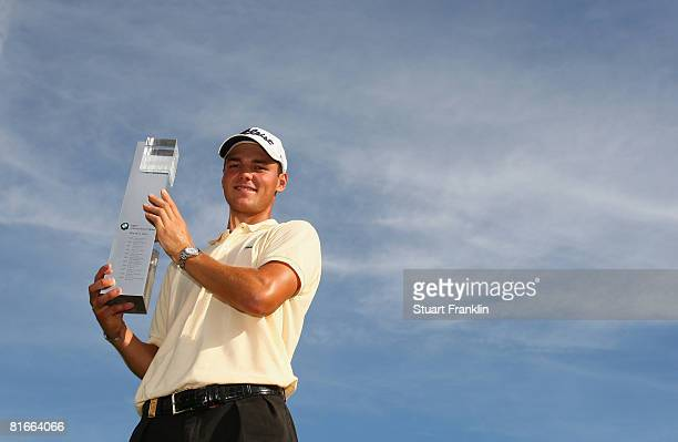Martin Kaymer of Germany holds the trophy for winning The BMW International Open Golf at The Munich North Eichenried Golf Club on June 22 in Munich...