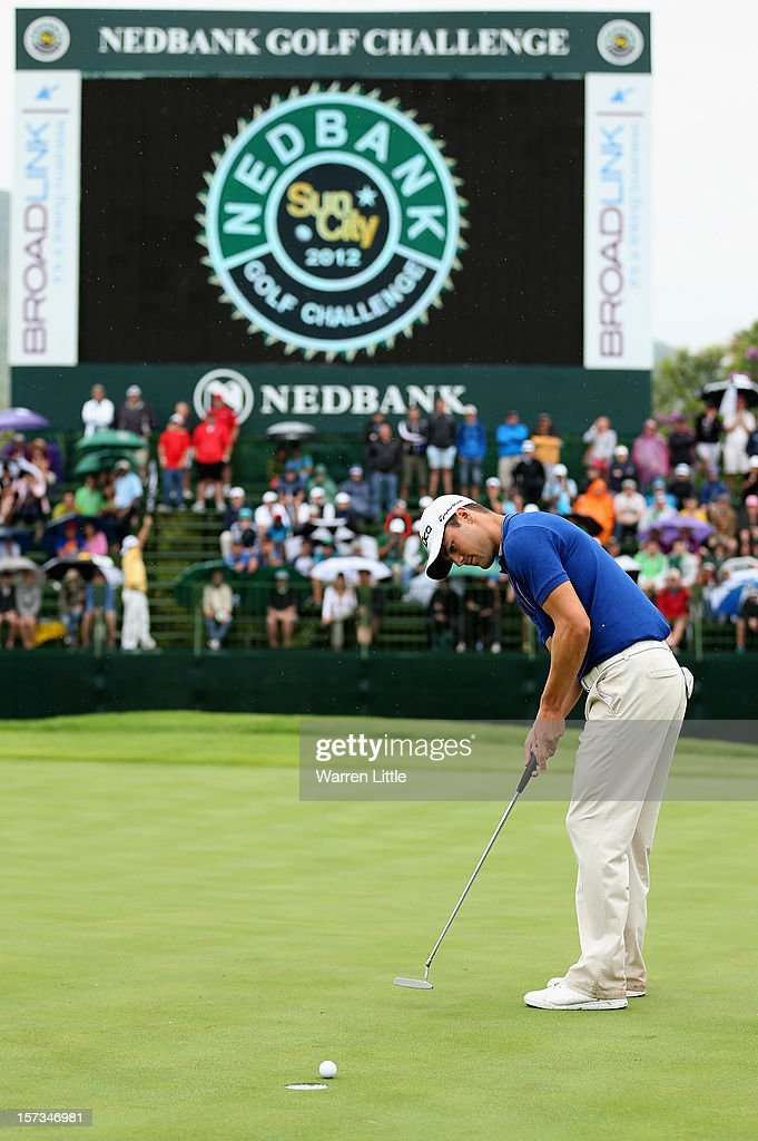 <a gi-track='captionPersonalityLinkClicked' href=/galleries/search?phrase=Martin+Kaymer&family=editorial&specificpeople=2143733 ng-click='$event.stopPropagation()'>Martin Kaymer</a> of Germany holes a putt to win the Nedbank Golf Challenge at the Gary Player Country Club on December 2, 2012 in Sun City, South Africa.