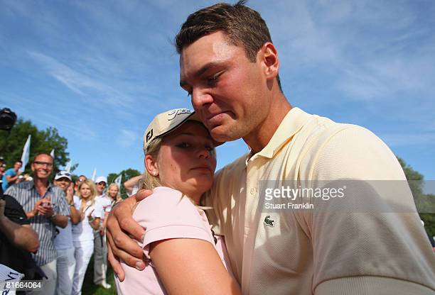 Martin Kaymer of Germany hugs his girlfriend Jenny as he bursts into tears after winning The BMW International Open Golf at The Munich North...