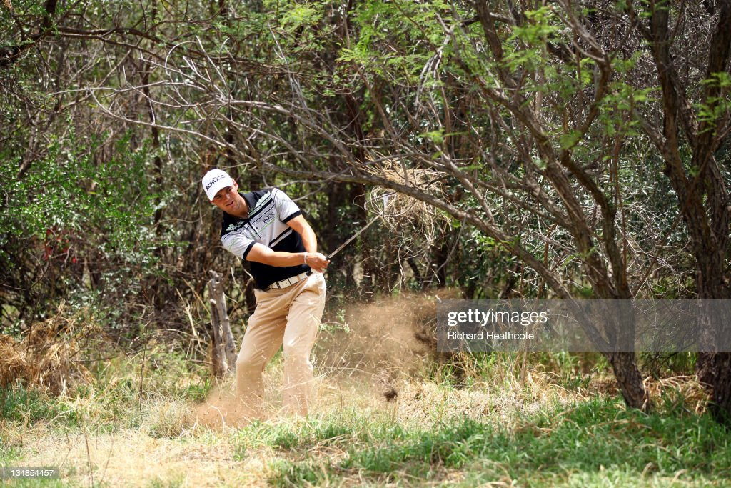 <a gi-track='captionPersonalityLinkClicked' href=/galleries/search?phrase=Martin+Kaymer&family=editorial&specificpeople=2143733 ng-click='$event.stopPropagation()'>Martin Kaymer</a> of Germany in action during the final round of the Nedbank Golf Challenge at the Gary Player Country Club on December 4, 2011 in Sun City, South Africa.