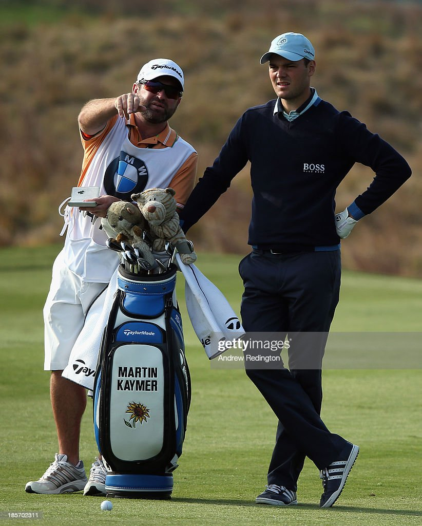 <a gi-track='captionPersonalityLinkClicked' href=/galleries/search?phrase=Martin+Kaymer&family=editorial&specificpeople=2143733 ng-click='$event.stopPropagation()'>Martin Kaymer</a> of Germany in action during the first round of the BMW Masters at Lake Malaren Golf Club on October 24, 2013 in Shanghai, China.
