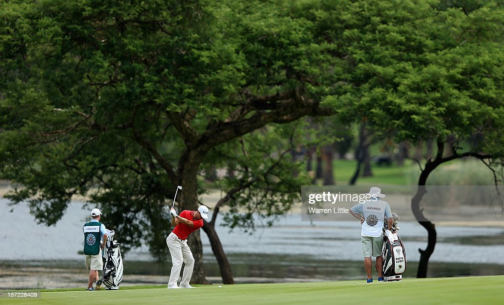 <a gi-track='captionPersonalityLinkClicked' href=/galleries/search?phrase=Martin+Kaymer&family=editorial&specificpeople=2143733 ng-click='$event.stopPropagation()'>Martin Kaymer</a> of Germany in action during the second round of the Nedbank Golf Challenge at the Gary Player Country Club on November 30, 2012 in Sun City, South Africa.