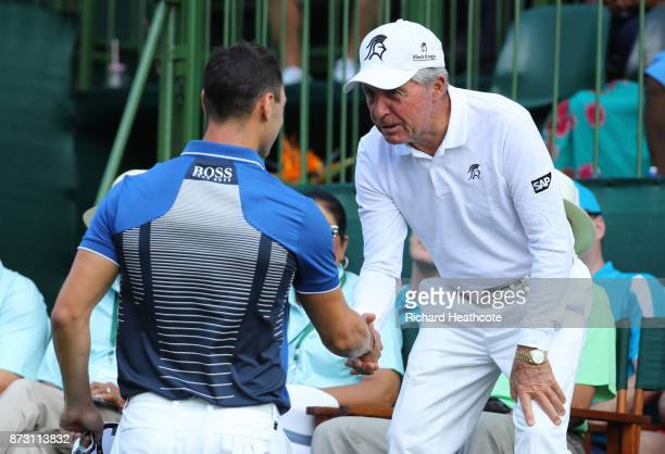 Martin Kaymer of Germany is greeted by Gary Player on the 1st tee during the final round of the Nedbank Golf Challenge at Gary Player CC on November...