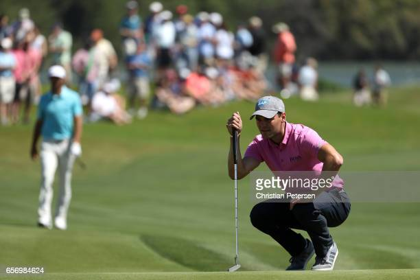 Martin Kaymer of Germany lines up a putt on the 15th hole of his match against Dustin Johnson during round two of the World Golf ChampionshipsDell...