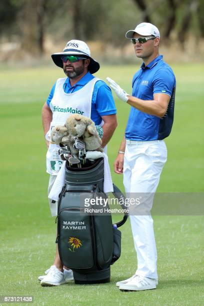 Martin Kaymer of Germany looks on with caddie Craig Connelly during the final round of the Nedbank Golf Challenge at Gary Player CC on November 12...