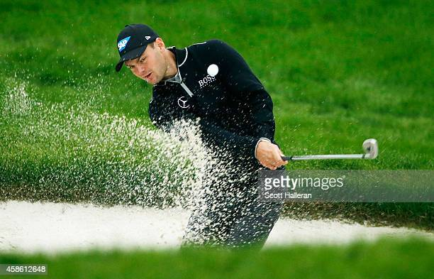 Martin Kaymer of Germany plays a bunker shot on the 15th hole during the third round of the WGC HSBC Champions at the Sheshan International Golf Club...