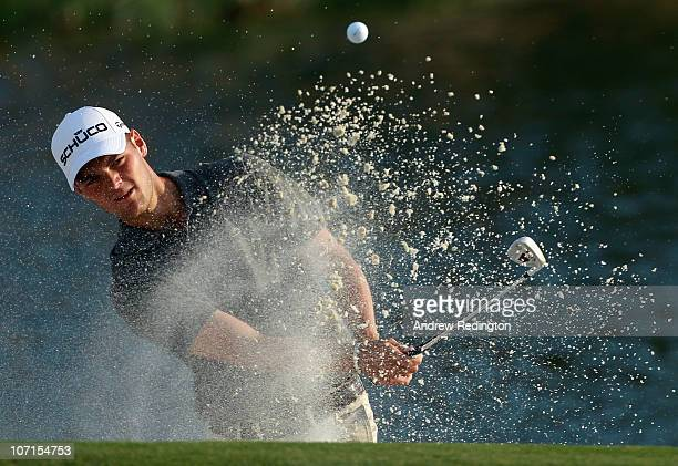 Martin Kaymer of Germany plays a bunker shot on the 17th hole during the second round of the Dubai World Championship on the Earth Course Jumeirah...