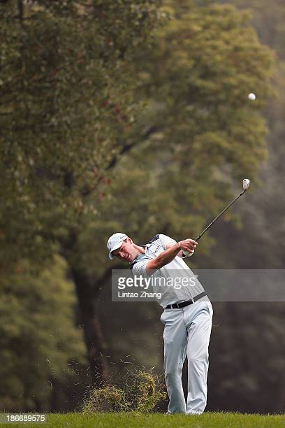 Martin Kaymer of Germany plays a shot during the final round of the WGC HSBC Champions at the Sheshan International Golf Club on November 3 2013 in...