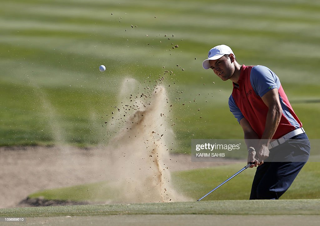 Martin Kaymer of Germany plays a shot during the second round of the Abu Dhabi Golf Championship at the Abu Dhabi Golf Club in the Emirati capital on January 18, 2013.
