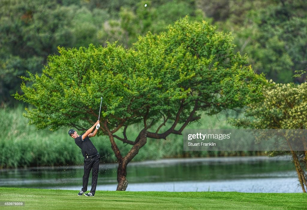 . Martin Kaymer of Germany plays a shot during the second round of the Nedbank Golf Challenge at Gary Player CC on December 6, 2013 in Sun City, South Africa.