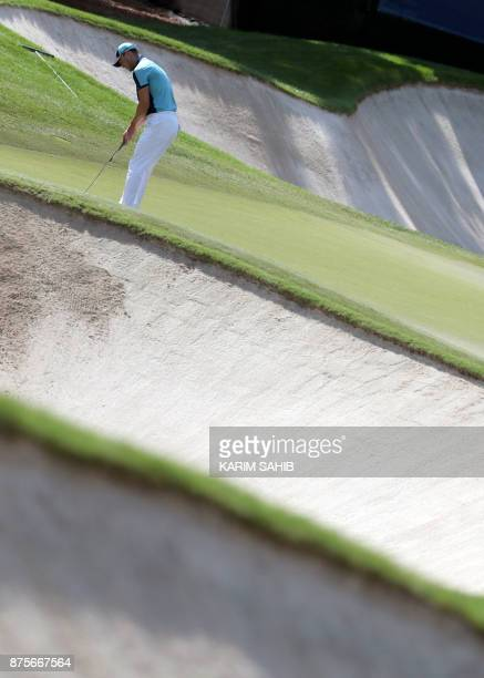 Martin Kaymer of Germany plays a shot during the third round of the DP World Tour Championship at Jumeirah Golf Estates in Dubai on November 18 2017...