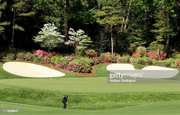 Martin Kaymer of Germany plays a shot to the 13th green during a practice round prior to the 2011 Masters Tournament at Augusta National Golf Club on...