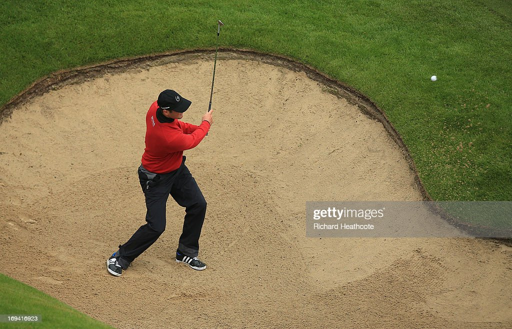 <a gi-track='captionPersonalityLinkClicked' href=/galleries/search?phrase=Martin+Kaymer&family=editorial&specificpeople=2143733 ng-click='$event.stopPropagation()'>Martin Kaymer</a> of Germany plays from a bunker into the 18th green during the second round of the BMW PGA Championship on the West Course at Wentworth on May 24, 2013 in Virginia Water, England.