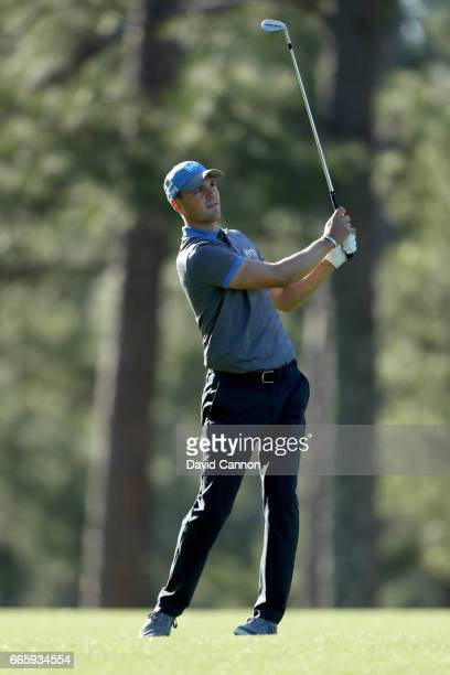 Martin Kaymer of Germany plays his second shot on the 14th hole during the second round of the 2017 Masters Tournament at Augusta National Golf Club...