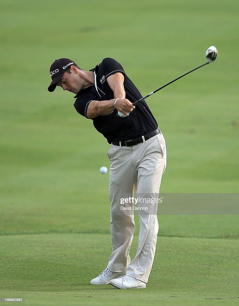 <a gi-track='captionPersonalityLinkClicked' href=/galleries/search?phrase=Martin+Kaymer&family=editorial&specificpeople=2143733 ng-click='$event.stopPropagation()'>Martin Kaymer</a> of Germany plays his second shot on the par 5, 18th hole during the second round of the 2012 DP World Tour Championship on the Earth Course at Jumeirah Golf Estates on November 23, 2012 in Dubai, United Arab Emirates.