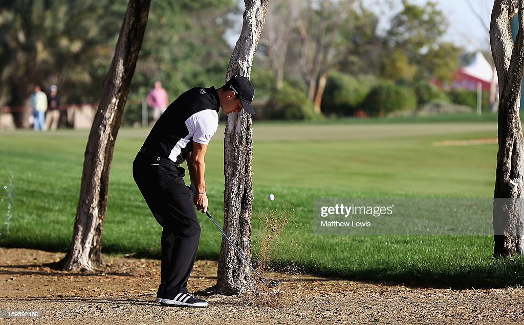 Martin Kaymer of Germany plays out of the rough on the 13th hole during day one of the Abu Dhabi HSBC Golf Championship at Abu Dhabi Golf Club on January 17, 2013 in Abu Dhabi, United Arab Emirates.