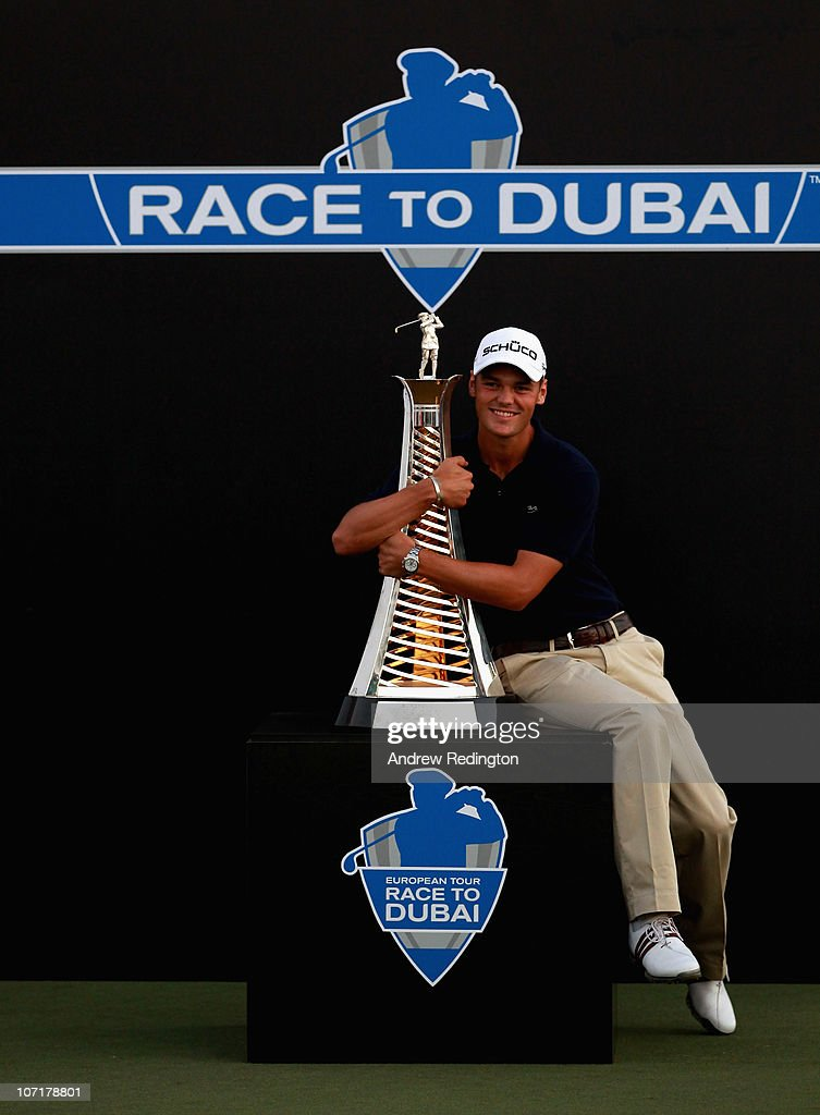 Martin Kaymer of Germany poses with the trophy after winning The Race To Dubai at the Dubai World Championship on the Earth Course Jumeirah Golf...
