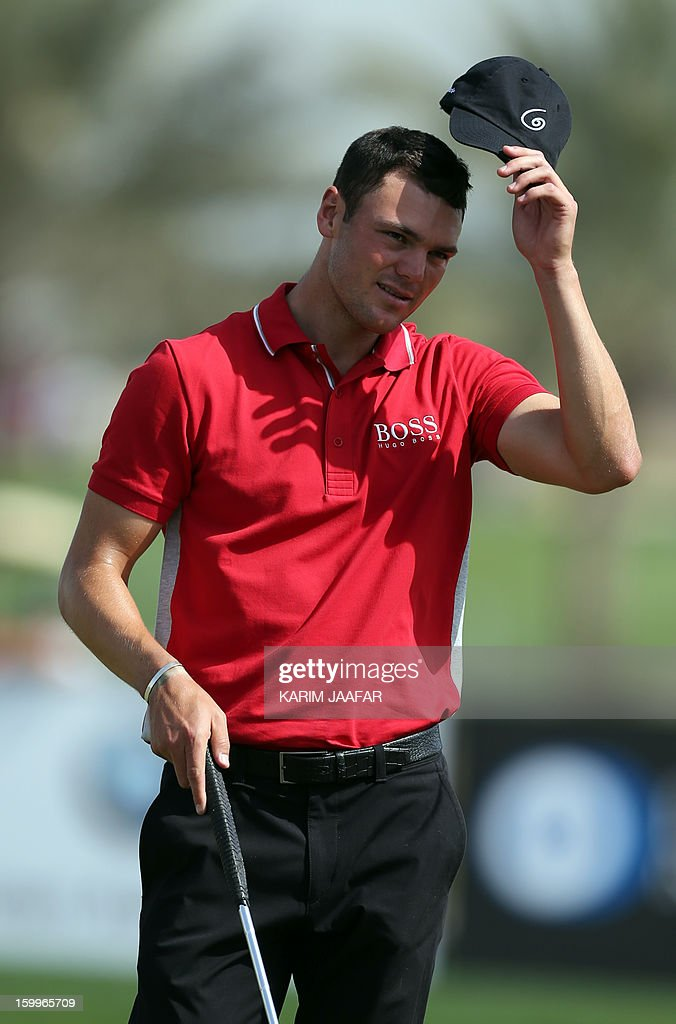 Martin Kaymer of Germany reacts after playing a shot during the second round of the Qatar Masters Golf tournament in Doha on January 24, 2013.