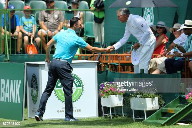Martin Kaymer of Germany shakes hands with Gary Player on the 1st tee during the third round of the Nedbank Golf Challenge at Gary Player CC on...