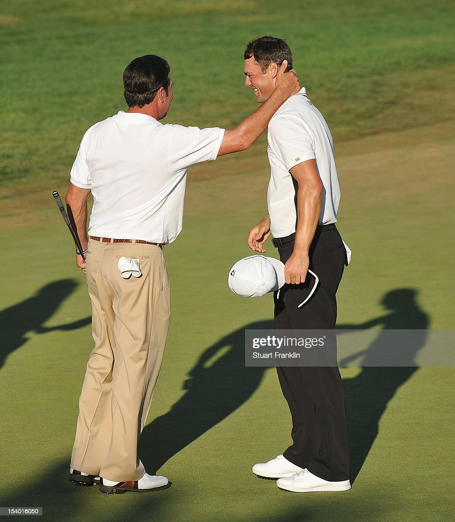 Martin Kaymer of Germany shakes hands with Ryder Cup captain Jose Maria Olazabal of Spain during the second round of the Portugal Masters at the Victoria golf course at Villamoura on October 12, 2012 in Faro, Portugal