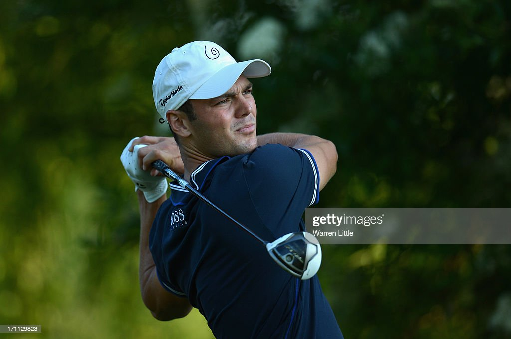 <a gi-track='captionPersonalityLinkClicked' href=/galleries/search?phrase=Martin+Kaymer&family=editorial&specificpeople=2143733 ng-click='$event.stopPropagation()'>Martin Kaymer</a> of Germany tees off on the 16th hole during the third round of the BMW International Open at Golfclub Munchen Eichenried on June 22, 2013 in Munich, Germany.