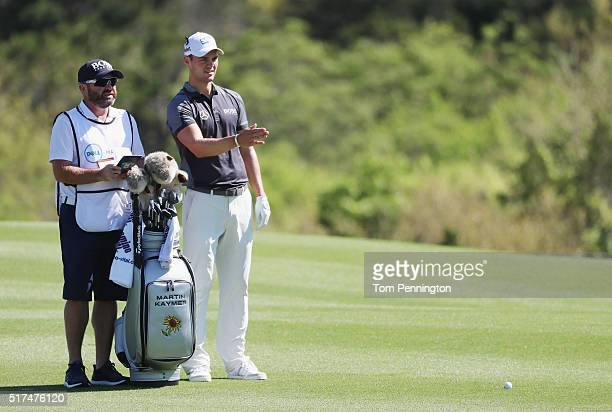 Martin Kaymer of Germany waits with his caddie Craig Connelly in the second fairway during the third round of the World Golf ChampionshipsDell Match...