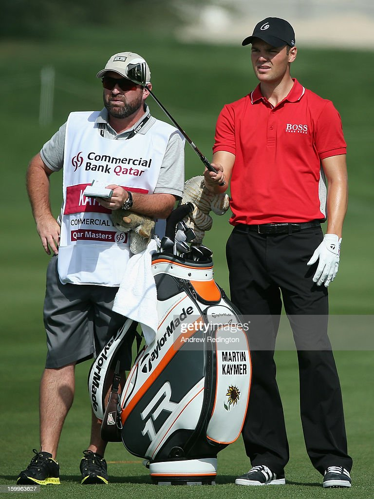 Martin Kaymer of Germany waits with his caddie Craig Connelly on the ninth hole during the second round of the Commercial Bank Qatar Masters held at Doha Golf Club on January 24, 2013 in Doha, Qatar.