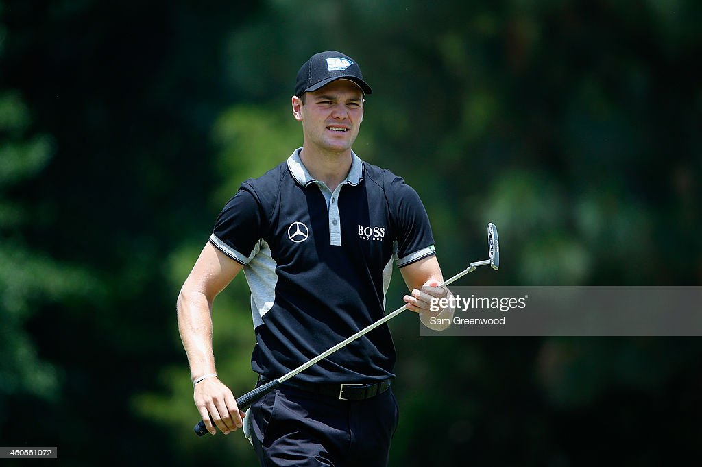 <a gi-track='captionPersonalityLinkClicked' href=/galleries/search?phrase=Martin+Kaymer&family=editorial&specificpeople=2143733 ng-click='$event.stopPropagation()'>Martin Kaymer</a> of Germany walks across a green during the second round of the 114th U.S. Open at Pinehurst Resort & Country Club, Course No. 2 on June 13, 2014 in Pinehurst, North Carolina.