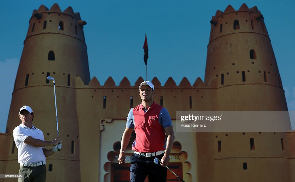 Martin Kaymer of Germany walks off of the 15th tee after Rory McIlroy of Northern Ireland tees off during the second round of the Abu Dhabi HSBC Golf Championship at the Abu Dhabi Golf Club on January 18, 2013 in Abu Dhabi, United Arab Emirates.