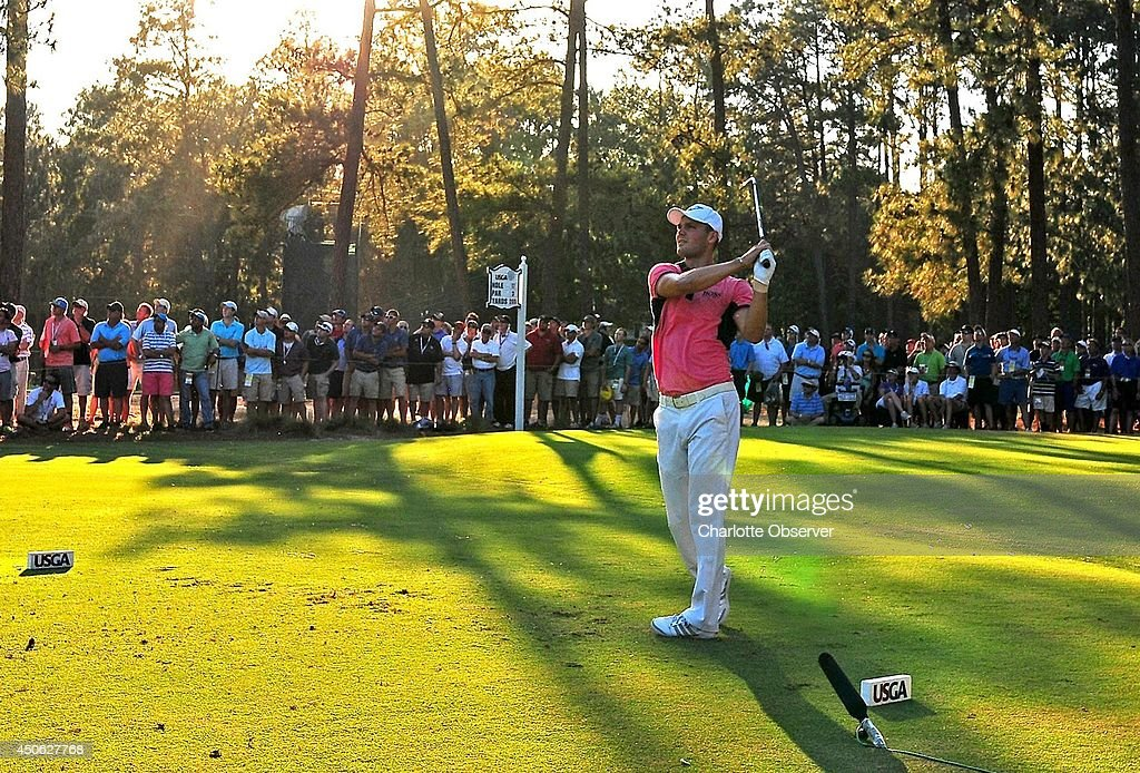 Martin Kaymer, of Germany, watches his drive from the 17th tee box as the evening sun begins to drape the course during third-round action at the 2014 U.S. Open at Pinehurst 2 in Pinehurst, N.C., Saturday, June 14, 2014.