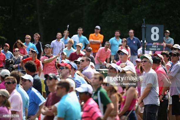 Martin Kaymer of Germany watches his tee shot on the eighth hole during the final round of THE PLAYERS Championship on The Stadium Course at TPC...