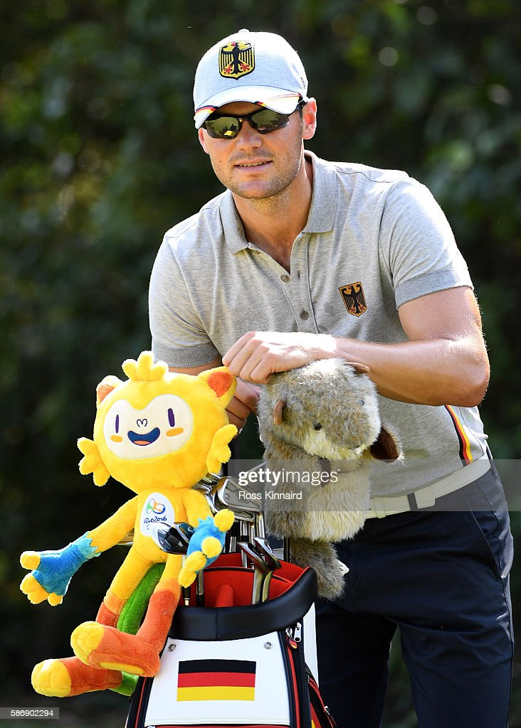Martin Kaymer of Germany with the Olympic mascott during a practice round on Day 2 of the Rio 2016 Olympic Games at Olympic Golf Course on August 7, 2016 in Rio de Janeiro, Brazil.