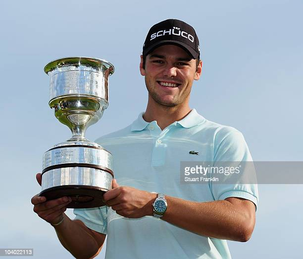 Martin Kaymer of Germay holds the trophy after winning The KLM Open Golf at The Hillversumsche Golf Club on September 12 2010 in Hilversum Netherlands