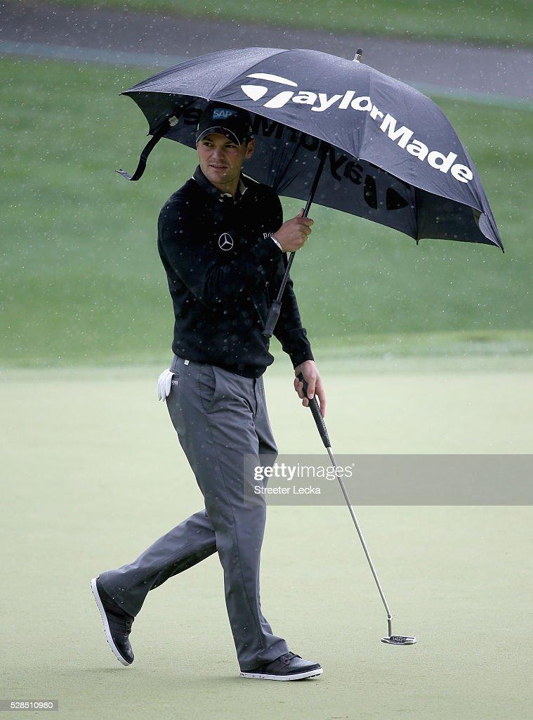Martin Kaymer stands in the rain on the second hole during the first round of the 2016 Wells Fargo Championship at Quail Hollow Club on May 5, 2016 in Charlotte, North Carolina.