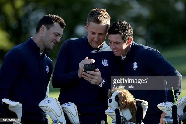 Martin Kaymer vicecaptain Ian Poulter and Rory McIlroy of Europe look on during team photocalls prior to the 2016 Ryder Cup at Hazeltine National...