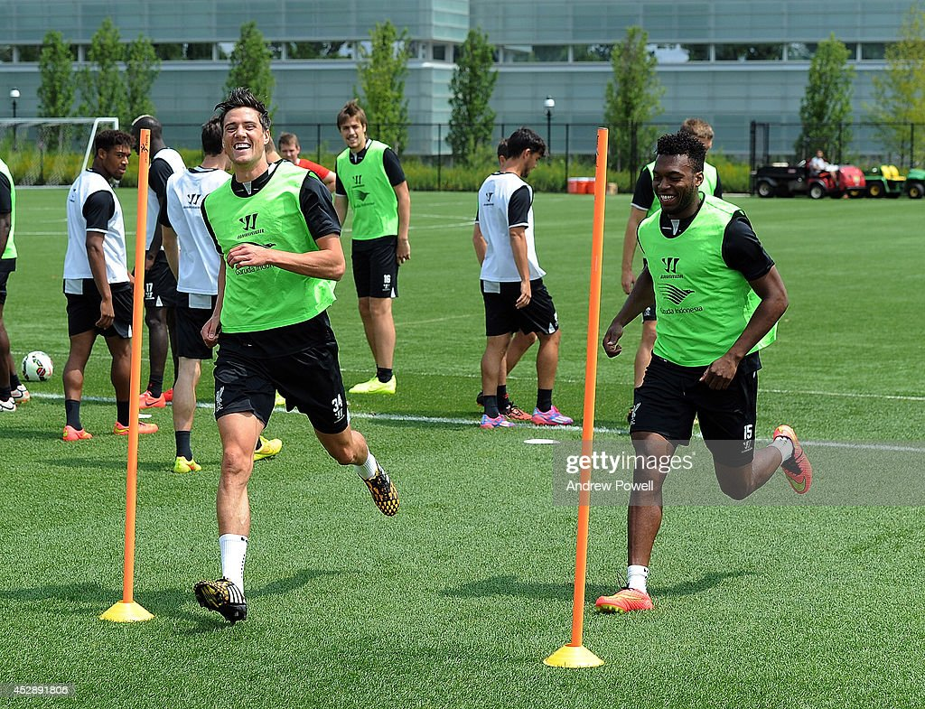 Martin Kelly and <a gi-track='captionPersonalityLinkClicked' href=/galleries/search?phrase=Daniel+Sturridge&family=editorial&specificpeople=677270 ng-click='$event.stopPropagation()'>Daniel Sturridge</a> of Liverpool in action during a training session at Princeton University on July 29, 2014 in Princeton, New Jersey.