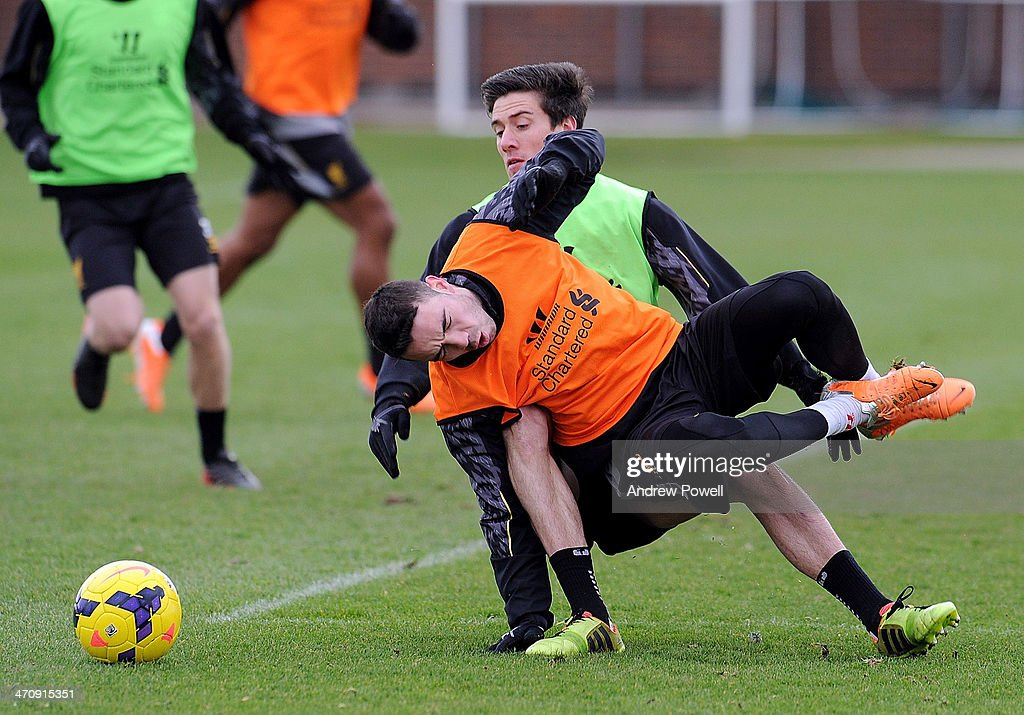 Martin Kelly and <a gi-track='captionPersonalityLinkClicked' href=/galleries/search?phrase=Iago+Aspas&family=editorial&specificpeople=6700373 ng-click='$event.stopPropagation()'>Iago Aspas</a> of Liverpool in action during a training session at Melwood Training Ground on February 21, 2014 in Liverpool, England.