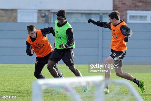 Martin Kelly and Ryan Kent take on Sheyi Ojo of Liverpool in action during a training session at Melwood Training Ground on January 3 2014 in...