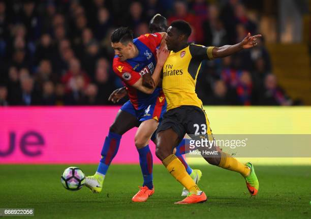 Martin Kelly of Crystal Palace and Danny Welbeck of Arsenal battle for the ball during the Premier League match between Crystal Palace and Arsenal at...