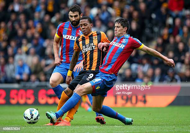 Martin Kelly of Crystal Palace battles for the ball with Abel Hernandez of Hull City during the Barclays Premier League match between Hull City and...