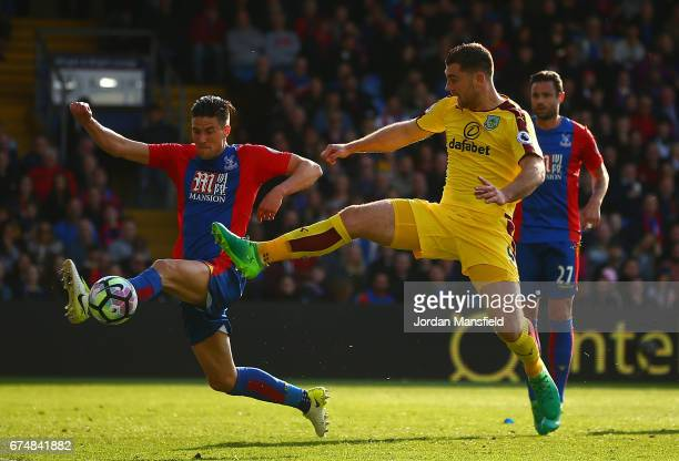 Martin Kelly of Crystal Palace challenges for the ball with Sam Vokes of Burnley during the Premier League match between Crystal Palace and Burnley...