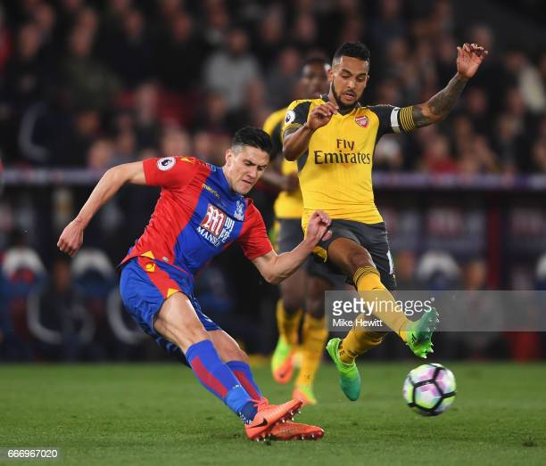 Martin Kelly of Crystal Palace is blocked by Theo Walcott of Arsenal during the Premier League match between Crystal Palace and Arsenal at Selhurst...