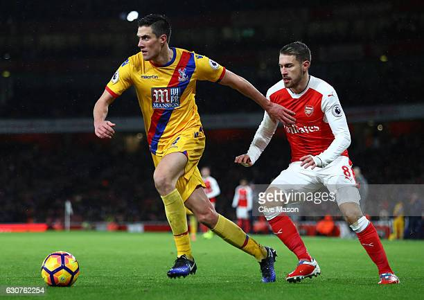 Martin Kelly of Crystal Palace is challenged by Aaron Ramsey of Arsenal during the Premier League match between Arsenal and Crystal Palace at the...