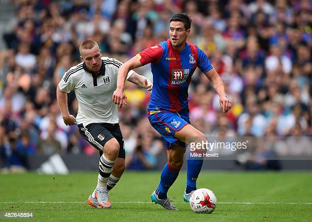 Martin Kelly of Crystal Palace is challenged by Jamie O'Hara of Fulham during a Pre Season Friendly between Fulham and Crystal Palace at Craven...