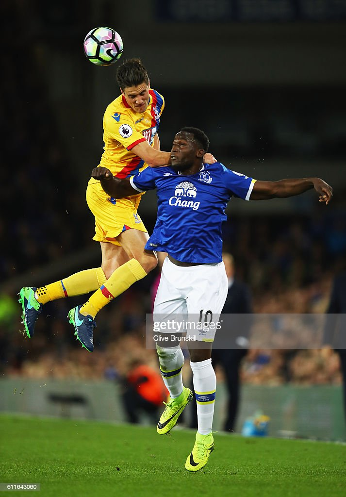 Martin Kelly of Crystal Palace outjumps Romelu Lukaku of Everton during the Premier League match between Everton and Crystal Palace at Goodison Park on September 30, 2016 in Liverpool, England.