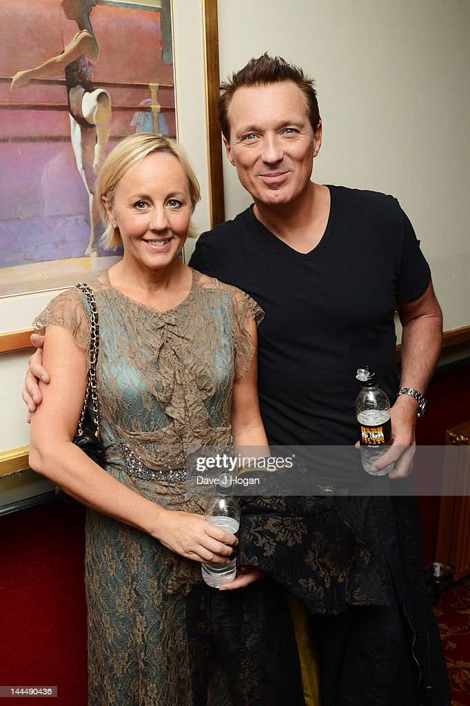 <a gi-track='captionPersonalityLinkClicked' href=/galleries/search?phrase=Martin+Kemp&family=editorial&specificpeople=213385 ng-click='$event.stopPropagation()'>Martin Kemp</a> and Shirley Holliman pose backstage at the We Will Rock You 10 year anniversary at The Dominion Theatre on May 14, 2012 in London, England.